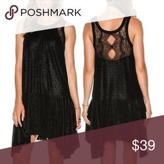 "Free People ""Make It Count"" Dress Free people make it count dress. Women's embossed mini dress. All over subtle polka dots with contrast lace panels at back yoke and straps.  Asymmetrical hemline. High collar. Contrast tone panels. Free People Dresses"