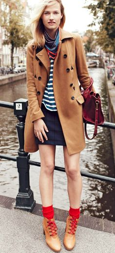A wonderful fall look, the casual chic navy with the tan peacoat and boots, with the accent of the red bag.