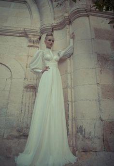 Majestic Yaki Ravid long sleeves wedding gown.