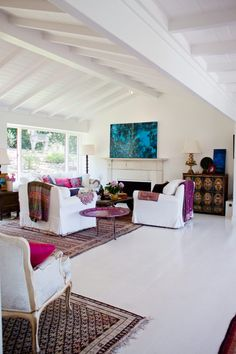 The canvas of bright white meets pops of internationally-sourced vibrant colors and textiles is just lovely.