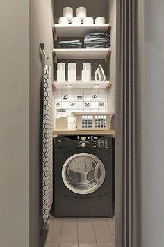 Mini espace pour une buanderie, lave linge et produits d'entretien et table à repasser
