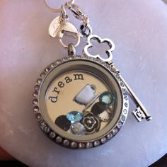Origami Owl Alice and Wonderland Inspired Locket. Love the key and rose. :)