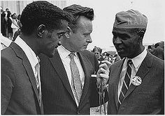 Sammy Davis Jr. (left) with Walter Reuther (center) and Roy Wilkins (right) at the 1963 March on Washington).