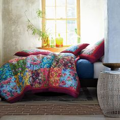 We love our Natalie quilt for its exuberant floral prints and lighthearted charm.