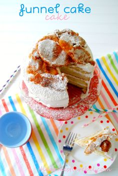No, it's not a typo. This is a funnel cake... cake. It is a cake topped with a funnel cake. Or a funnel cake atop a cake. Really, whichever way you slice it, it's truly a cake cake. And just so...