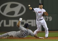 CrowdCam Hot Shot: Boston Red Sox shortstop Stephen Drew turns a double play and Tampa Bay Rays designated hitter Delmon Young is forced out during the eighth inning in game two of the American League divisional series playoff baseball game at Fenway Park. Photo by Bob DeChiara