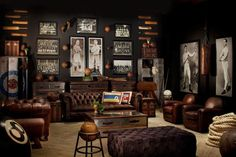 Restoration Hardware sports room/man cave with masculine elements.  Brown leather chesterfield sofa, tufted leather ottoman, old world touches, and vintage prints and etchings.  I really like the aluminum trunks and club chairs, but I'm not sold on the lo