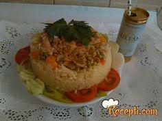 Recept za Maklube sa Ras el Hanut. Za spremanje ovog jela neophodno je pripremiti kim, đumbir, so, biber, cimet, korijander, čili, slačicu, pileće batake, krompir, šargarepu, pirinač, grašak.