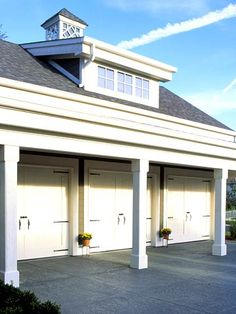 Triple garage with the feel of a vintage carriage house. A dormer and cupola break up the large roofline and bring light to the garage interior. Garage Renovation, Garage Interior, Garage Makeover, Door Makeover, Garage Guest House, Garage Loft, Car Garage, Garage Door Hardware, Garage Doors