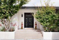 I love the door.  It feels so indoor/outdoor Home Tour: Inside An Interior Designer's Midcentury Renovation via @domainehome