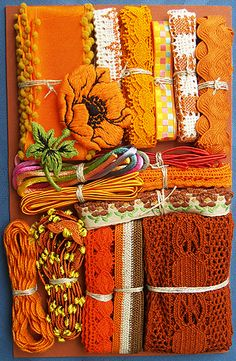 Orange Crazy Quilt Embellishment Assortment - A variety of vintage and new materials. Each orange assortment is one of a kind and unique, and may include some of the following items: ribbons, trim, lace, pearl buttons, venise, embroidery thread, and even old stamps. Price: $30.00