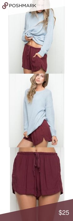 """Brandy Melville High Waisted Shorts Burgundy •Soft woven cotton pull-on shorts  • burgundy  • elasticized drawstring waistband,  •side pockets and  • scalloped side slits. • 58% cotton, 42% viscose • 9"""" rise, 2.5"""" inseam, 13"""" waist (stretch and drawstrings • one size • in excellent pre loved condition • Photos 1, 2 & 3 - BM Brandy Melville Shorts"""