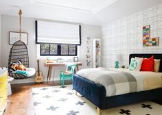 Arcade accents and cassette tapes offer a playful nod to the '80s in this contemporary boy's room from J&J Design Group. With a clean backdrop of graphic black and white prints, the space feels fun yet sophisticated.