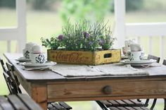 Create a table scape with rustic charm: Add mason jars to a vintage coke or milk crate and fill the jars with wildflowers! www.cedarhillfarmhouse.com