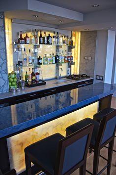 Artistic Tile I This Upper West Side penthouse bar makes stunning use of back-li. Basement Bar Plans, Basement Bar Designs, Billard Bar, Modern Home Bar Designs, Home Bar Essentials, Small Bars For Home, Bar Counter Design, Indoor Bar, Game Room Bar