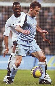 Man City 1 Tottenham 2 in Dec 2006 at Eastlands. Ledley King keeps close on Paul Dickov 2 In, Running, City, Sports, Racing, Hs Sports, Sport, Jogging, Lob