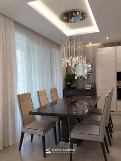 Visszafogott színvilágú felületek, csillogó króm lámpák jellemzik ezt az otthont. A modern geometrikus vonalvezetésű bútorok és lámpák, a fényes és matt felületek játékának összhatása megnyugtató, otthonos, de mégis elegáns hangulatot teremt. Tervező/Designer: Erdélyi Krisztina, www.erdelyikrisztina.hu #elegans#exkluziv#modern#home#design#interior#erdelyikrisztina#lakberendezo#belsoepitesz Conference Room, Table, Furniture, Modern, Home Decor, Elegant, Trendy Tree, Decoration Home, Room Decor