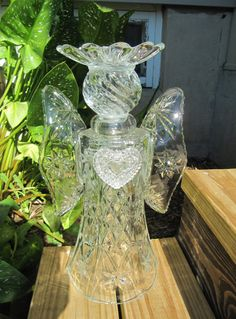 a large angel designed to sit in your garden and shine! I has been made from recycled glass, purchased at antique or thrift stores. It has been bonded together with the highest quality glass adhesive, designed for this purpose, and will not come apart. Glass Garden Flowers, Glass Plate Flowers, Glass Garden Art, Garden Deco, Garden Yard Ideas, Garden Crafts, Garden Whimsy, Garden Junk, Wooden Garden