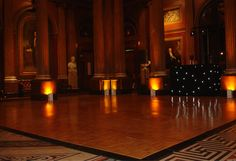 Traditional parquet wooden dance floor with black star cloth DJ booth and static up lights with a yellow / orange gel colour - perfect for a more historic venue Gel Color, Colour, White Lead, Black And White, Led Dance, Dance Floors, Dj Booth, Black Star, Orange
