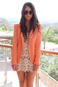 Coral blazer and lace dress