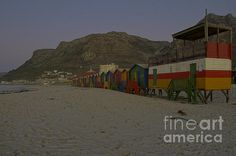 The beautiful beach houses on Muizenberg beach, a suburb of Cape Town, South Africa. The beach is considered to be the birthplace of surfing in South Africa.