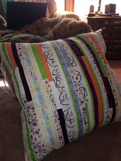 I'm calling it a tv pillow for the floor.  Sewn from selvages of fabric - like a jellyroll quilt.  Pillow given to my nieces, Terri Hutton for her girls.