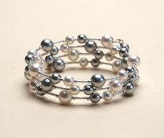 This memory wire bracelet for large wrists combines classic white and lovely light silver gray Swarovski crystal pearls . The simplicity -- even purity -- of this color scheme creates a silver toned bracelet that should work well with any other silver jewelry, right for almost any occasion. This bracelet was designed to work well for a wrist of approximately 8 inches ( 7.5 to 8.5 inches). In the model shot, Ive wrapped a similar bracelet around the point on my forearm that is 8 inches…