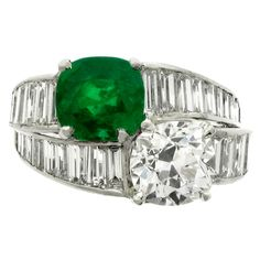 TIFFANY & CO. Emerald Diamond Ring  | From a unique collection of vintage engagement rings at https://www.1stdibs.com/jewelry/rings/engagement-rings/