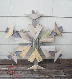 This Christmas pallet snowflake can be hung or propped up on front porch.