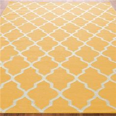 Diamond Trellis Dhurrie Rug A classic yet chic trellis pattern is featured in today's trend colors. Constructed of 100% wool, this dhurrie rug is ultra durable and reversible for a double life! Fashionable colors include: Burnt Orange, Apple Green, Peacock Teal blue, Yellow, Stone Blue, or Chocolate, all with cream design outline