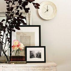 like the idea of a leaning gallery on a ledge, shelf, table