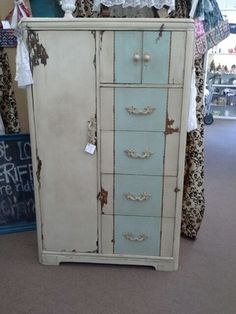 SOLD - Antique Armoire - two tone paint finish with dark wax. Four drawer, hat box and wardrobe side close. ***** In Booth D8 at Main Street Antique Mall 7260 E Main St (east of Power RD on MAIN STREET) Mesa Az 85207 **** Open 7 days a week 10:00AM-5:30PM **** Call for more information 480 924 1122 **** We Accept cash, debit, VISA, Mastercard, Discover or American Express