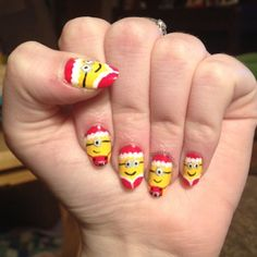 Christmas Minion Nails by @nailedpolish
