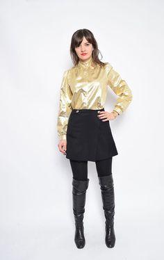 He encontrado este interesante anuncio de Etsy en https://www.etsy.com/es/listing/489689968/vintage-anos-80-camisa-de-oro-metalico