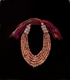 Exhibitions Philadelphia. Desert Jewels: North African Jewelry and Photography. The Philadelphia Museum of Art. Necklace Late 20th Century, Marrakech, Morocco Coral, amazonite, metal rosettes, wool.