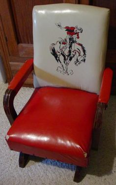 Crazy cute vintage child's cowboy rocking chair. Crazy cute vintage child's cowboy rocking chair.