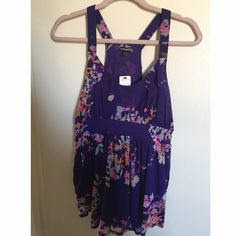 Express multi-floral purple top size Medium Express multi-floral-purple tank top, flowy & stretchy, body:100% nylon lining:100% polyester. NWT Express Tops Tank Tops