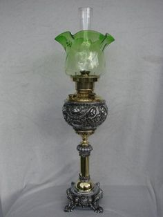 19th C MILLER CENTRE DRAUGHT OIL LAMP, EMBOSSED BRASS & BASE METAL, GREEN SHADE