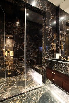 Luxury Lifestyle - Masculine bathroom. Portoro marble. Luxury triple...