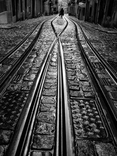 """""""Wet Day, Lisboa, Portugal"""", by Rui Palha. From his beautiful """"Rainy days"""" series. White Picture, Photo Black, B&w Tumblr, Black N White Images, Train Tracks, Black And White Photography, Street Photography, Monochrome, Around The Worlds"""