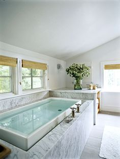 The luxurious soaking tub in the master bath is surrounded by sleek Carrara marble.
