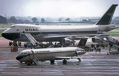 Manchester Airport - The arrival of Boeing 747-136 of BOAC, the first wide bodied aircraft to land there. A BAC-111 G-AWNC of Caledonian is parked in front. 17th August.1970