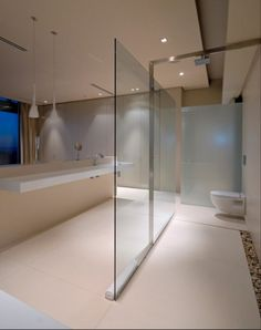 Bathroom,Contemporary Large Walk In Shower Designs With Glass Divider Also Rain Head Shower Added Floating Vanities In Modern Bathroom Decors,Have A Wonderful Shower Experience With Marvelous Walk In Shower Designs