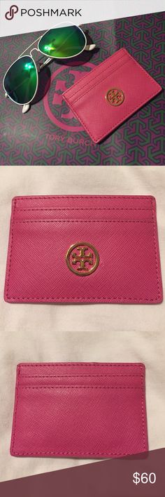 Tory Burch gorgeous pink leather card case NWOT! This super cute Tory Burch leather card case has two card pockets on each side plus one center pocket. It features a gold Tory Burch emblem on one side. So beautiful! There is a teeny tiny imperfection in the leather to the right of the emblem - hardly noticeable and naturally occurring but I mention because my policy is 100% honesty in all listings! Visible if you zoom in on the second pic. Tory Burch Bags Wallets