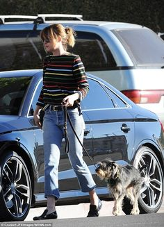 Relaxed: The daughter of Melanie Griffith and Don Johnson wore her brunette hair up in a c...