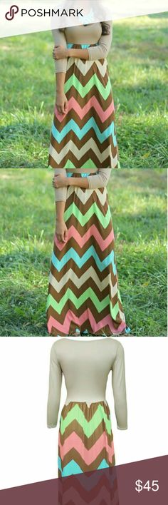 Long Sleeve Maxi Dress Be assured that this stunning piece will flatter your figure. A floor length maxi dress boasts a cinch in just the right place on your waist. Generously stretchy for the comfort you desire without discounting style, this super cute solid light green/tan colored top is complimented by the cool chevron detail at the bottom. A truly glamorous bohemian style for your collection. C-45 Dresses Maxi
