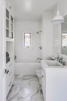 Looking for Transitional Bathroom and Small Bathroom ideas? Browse Transitional Bathroom and Small Bathroom images for decor, layout, furniture, and storage inspiration from HGTV. Marble Bathroom Floor, White Bathroom, Master Bathroom, Marble Floor, Shelves Over Toilet, Mini Bad, Bungalow Homes, Transitional Bathroom, White Houses