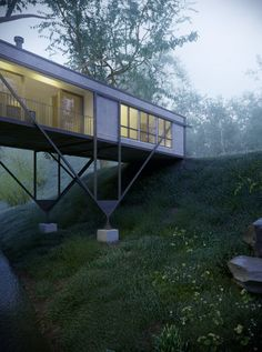"""Architect Max Pritchard designed the Bridge House, which is situated near Adelaide, Australia, creating a plan that respects to the Aboriginal """"Touch the"""