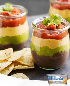 These cute single-serve appetizer cups are sure to be a hit at your next party. With layers of refried beans, guacamole, creamy cheddar cream cheese and salsa, what's not to love? Layer Dip, Party Dips, Refried Beans, Easy Meal Prep, Cheddar, Guacamole, Cooking Tips, Healthy Snacks, Salsa