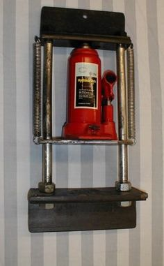 Barrel Vise Press by rbertalotto -- Homemade barrel vise press powered by a 6-ton hydraulic jack and mounted to an angle iron frame. http://www.homemadetools.net/homemade-barrel-vise-press